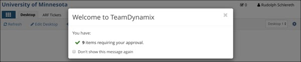 """A TDX window saying """"Welcome to TeamDynamix. You have nine items requiring your approval.""""Below the message is a checkbox labeled """"Don't show this message again"""""""